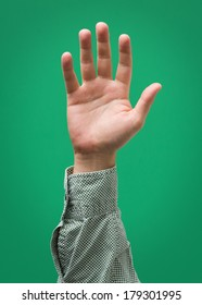 Raised Male Hand Isolated on Green