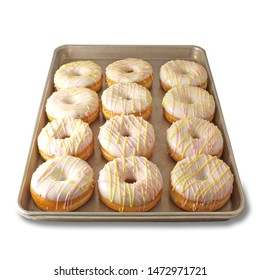 Raised Ring Donuts On A Sheet Pan with White Icing Drizzled with Pink and Yellow String Icing
