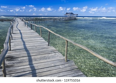 raised wooden walkway for surfers to cross the reef of siargao island to cloud 9 surf break mindanao the philippines