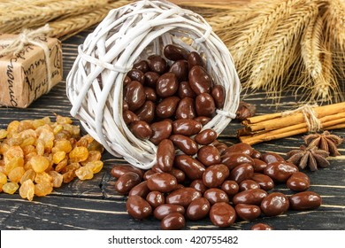 raisin with chocolate nuts cinnamon and star anise  on wood background