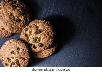 Raisin cookies on a dark background