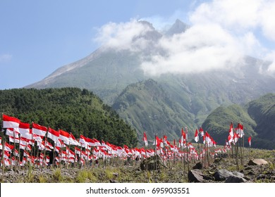Raising 1000 red and white flags when celebration of Indonesian Independence Day at Kaliadem, Cangkringan, Yogyakarta, Indonesia with view of Merapi Mountain