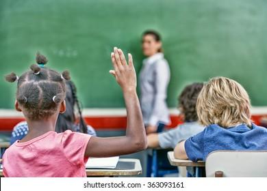 Raising hand at primary school. Success concept.