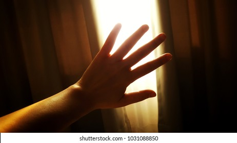 Raising left hand to against morning light passing through the curtains. Don't want to wake up and I hate monday, concept