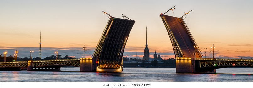 Raising Palace Bridge (Dvortsovy), Saint Petersburg, Russia. It is a landmark of St Petersburg. Panoramic view of Saint Petersburg at White Nights. Peter and Paul Fortress behind the divorce bridge.