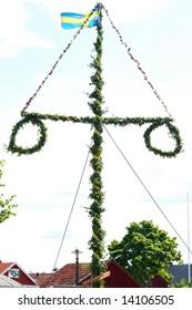 Raising of a traditional Swedish maypole
