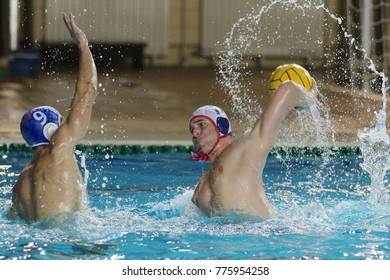 Raising water polo star Zlatan Nikocevic shooting while player from opposite team tries to defend him from scoring goal. Wallpaper, background...