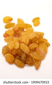 Raisins isolated on a white background.