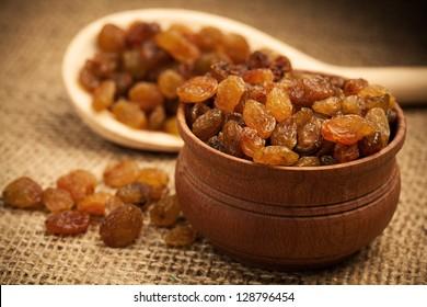 Raisins on a wooden spoon