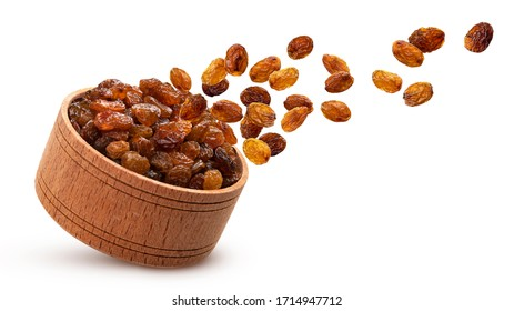 Raisins in wooden bowl isolated on white background with clipping path