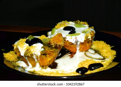 Raj kachori with dahi chutney and grapes