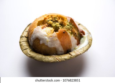 Raj Kachori served with dahi Or Curd and imli chutney. Selective focus and moody background