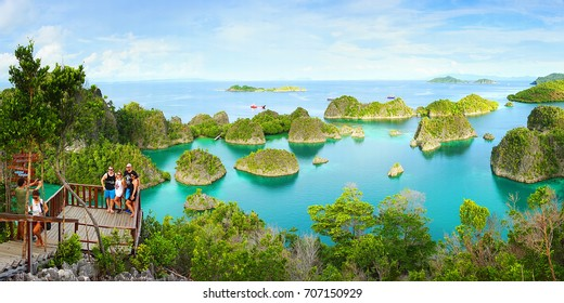 Raja Ampat, Indonesia - April 04, 2017:  Tourists makes photos at  view point in Raja Ampat national marine park, Blue Lagoon of Painemo Island, West Papua, Indonesia, Asia.
