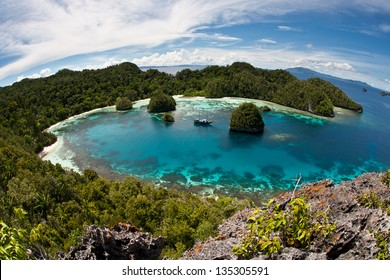 In Raja Ampat, Indonesia, a protected bay, surrounded by limestone islands, harbors beautiful fringing reefs that support a diversity of fishes and invertebrates.