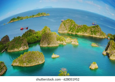 Raja Ampat marine park, Blue Lagoon next to Painemo Island among small islands in the Indian ocean, in West Papua, Indonesia, Asia. planet Eath is a sphere concept.