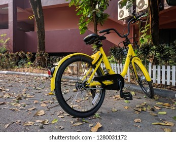 Rajamangala University of Technology Thanyaburi, Pathum Thani / Thailand - January 27, 2018 : ofo yellow bicycle in public park of University