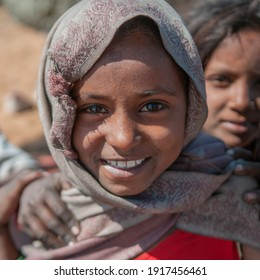 Rajasthan. India. 05-02-2018. Portrait of a woman laughing while playing with other friends from her community.