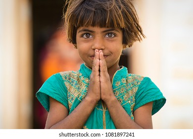 RAJASTHAN - INDIA - 20 December 2017. Portrait of a beautiful young girl with her folded hands. Picture taken from a rural village in Rajasthan. India.