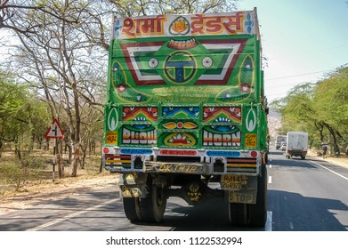 Rajasthan, India - february 21, 2006: Decorated rear part of a transport truck circulating on an access road to the city of New Delhi