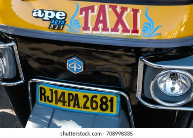 RAJASTHAN, INDIA - FEBRUARY 22, 2006: Detail of the front of a tuk-tuk taxi in the streets of Jaipur