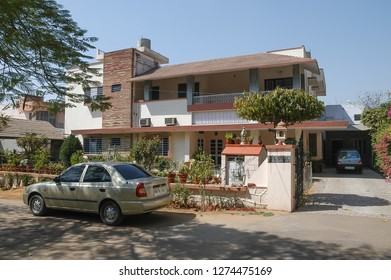 Rajasthan, India - February 23, 2006: Cars parked and outside view of a house in a residential neighborhood of the city of Jaipur