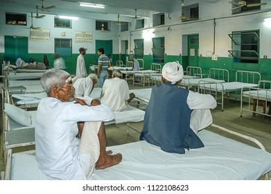 Rajasthan, India - february 26, 2006: Peasants sitting on the beds in a hospital care room in the city of Jaipur