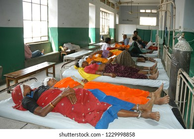 Rajasthan, India - February 26, 2006: Peasant women lying on several beds, waiting to be treated at Jaipur hospital