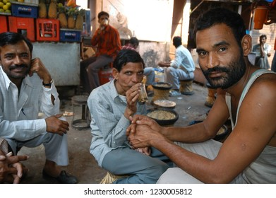 Rajasthan, India - February 26, 2006: Close-up with a group of men and young people sitting inside a street restaurant in the city of Jaipur