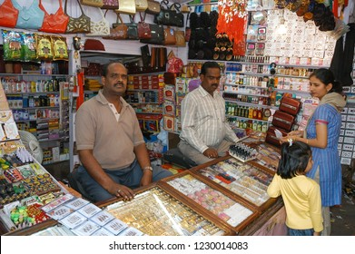 Rajasthan, India - February 26, 2006: Dependents and customers inside a cosmetics shop and accessories for women, in a central street of the Jaiupr bazaar