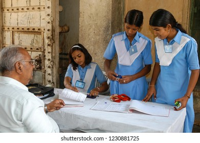 Rajasthan, India - February 26, 2006: Young school girls volunteering at a field hospital in Naila Fort, near the city of Jaipur