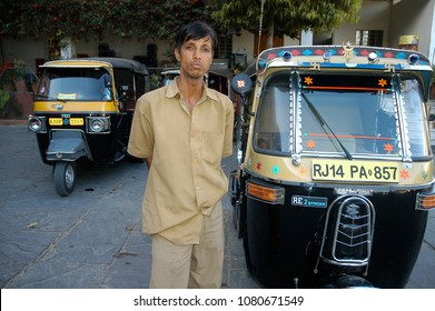 Rajasthan, India - february 28, 2006: Uniformed driver in a tuc tuc station outside the Nahargarh fort of Jaipur