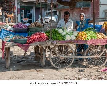 RAJASTHAN, INDIA - FEBRUARY 3, 2011: Rajasthani people sell vegetables at a small village market. Rajasthani people are known as some of the most colorful people in India.