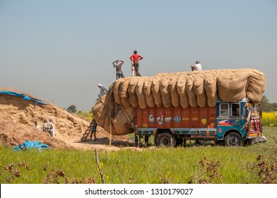 RAJASTHAN, INDIA - FEBRUARY 3, 2011: Loading of a truck in the countryside of Rajasthan. Trucks carrying heavy loads characterize traffic in India.
