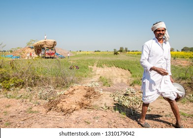 RAJASTHAN, INDIA - FEBRUARY 3, 2011: Smiling agricultural worker in the countryside of Rajasthan. Rajasthani people are known as some of the most colorful people in India.