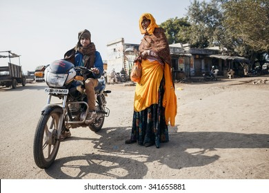 RAJASTHAN, INDIA - JANUARY 9, 2015: Men in traditional clothes with motorbike on January 9, 2015 in Rajasthan, India