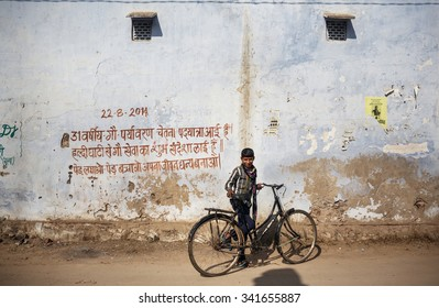 RAJASTHAN, INDIA - JANUARY 9, 2015: Little boy with bicycle on the street on January 9, 2015 in Rajasthan, India