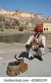 RAJASTHAN, INDIA - MARCH 03, 2006: Snake charmer outside Amber Fort in Jaipur
