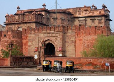 RAJASTHAN, INDIA - MARCH 03, 2006: The tuk-tuk , small taxis in India , waiting at the gates of Junagarh , Red Fort of Bikaner