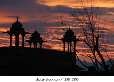 RAJASTHAN, INDIA - MARCH 03, 2006: Sunset and towers of a palace in Rajasthan