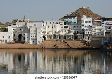 RAJASTHAN, INDIA - MARCH 03, 2006: Pushkar houses reflected in the sacred lake, India