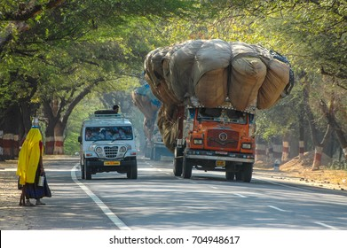 RAJASTHAN, INDIA - MARCH 05, 2006: Scene with motion blur, of a vehicle overtaking a truck with overload, on a highway in the region