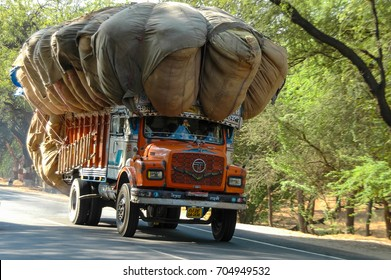 RAJASTHAN, INDIA - MARCH 05, 2006: Scene with motion blur of a truck with overload, circling on a road in the region