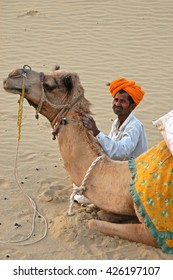RAJASTHAN, INDIA - MARCH 14, 2006: A man of the desert with his camel in the Thar , Rajasthan , India