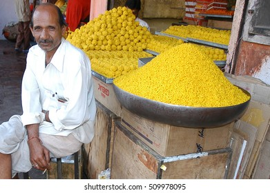 RAJASTHAN, INDIA - MARCH 14, 2006: Stall selling sweets, on a street in Jaipur