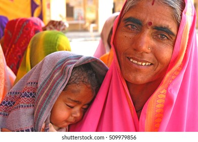 RAJASTHAN, INDIA - MARCH 14, 2006: Woman with a baby, in the village of Naila