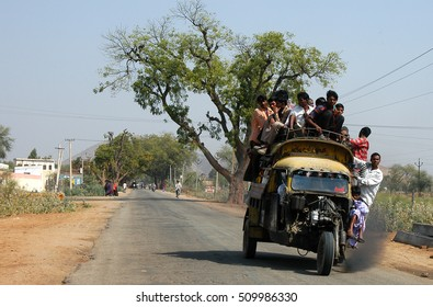 RAJASTHAN, INDIA - MARCH 14, 2006: Old motorcycle taxi, overloaded with passengers, on a road in the Naila district