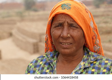RAJASTHAN, INDIA - MARCH 16, 2018: Indian woman working on brick factory in Rajasthan, India