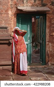 RAJASTHAN, INDIA - MARCH 20, 2006: Woman at the door of his house in Jodhpur