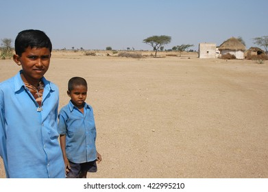 RAJASTHAN, INDIA - MARCH 20, 2006: two boys in the fields of Rajasthan