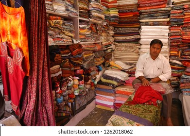 Rajasthan, India - March 25, 2006: Shopkeeper inside a fabric store in the commercial area of the city of Jaipur
